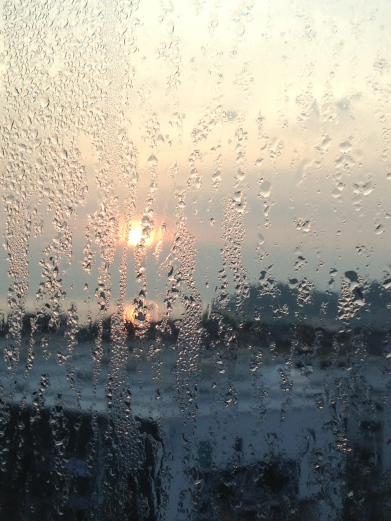 The sunrise from my misty window in Penang